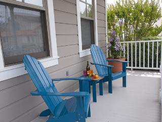 Our front porch, perfect for people watching, sipping wine, & connecting w/ friends.