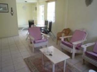LIVING ROOM/DINING with DOOR TO VERANDAH on RIGHT