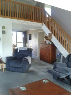 Mezzanine and second lounge with sofa beds for extra people.