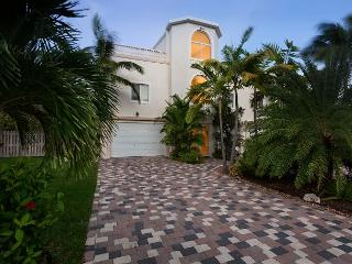 Lovely home on beautiful Coco Plum with 100' of deep water dockage!