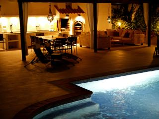 Spacious poolside entertainment area, perfect for late nights.