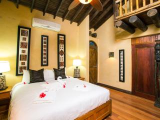 Get R&R in the Tropicale Suite at Caribe Tesoro