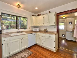 Updated fully equipped kitchen with view to the laundry room.