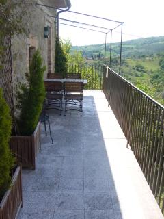 Villa La Rogaia apartment La Nostalgia - the view from your balcony over the green hills of Umbria