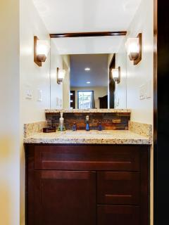 Custom countertops and cabinets in both the kitchenette and bathroom!