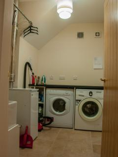 Utility room with Belfast sink, washing machine, tumble drier, ironing board, iron, vacuum cleaner