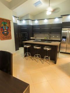 Main kitchen with granite counter top, all Villa Bonita 1 & 2 eight kitchens with granite or quartz