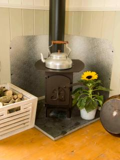Enjoy a cuppa the old fashioned way and boil the kettle on the wood burning stove inside the Hut