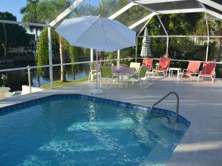 Excellent furnished vacation home on waterfront with big poolarea and boatdeck