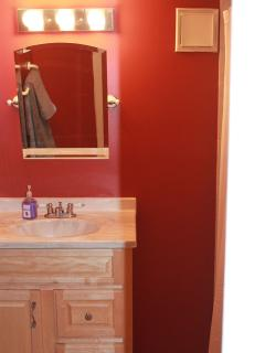 Clean and updated bathroom with full sized shower and tub.