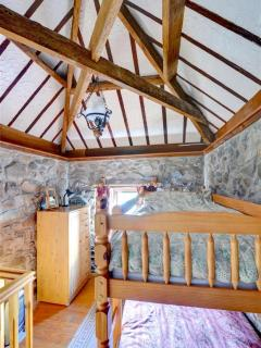 Upstairs is an 'attic' bunk bedded room with fascinating open roof trusses