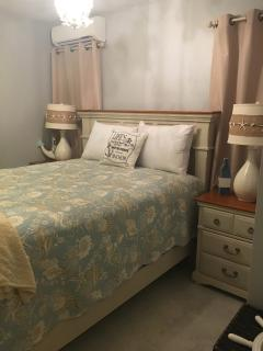 This lovely nautical themed bedroom has its own ensuite very large bathroom and a walk in closet.