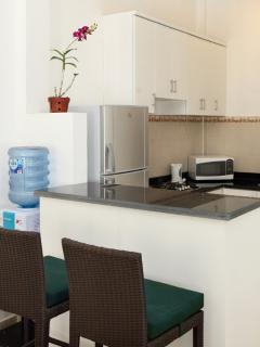 Kitchen with gas stove, microwave oven, fridge/freezer, crockery and cutlery if you want to cook