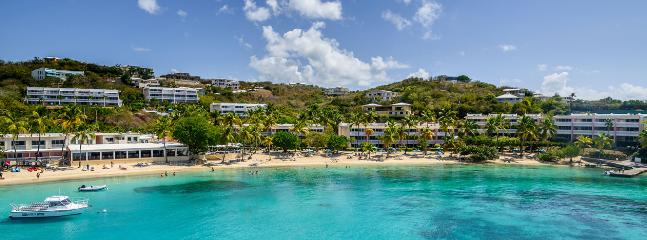 Secret Harbour Beach with a beachside bar and Aqua Action Dive Center. Specials rates for my guests!