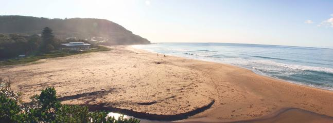 Stanwell Park Beach is patrolled and a 5 minute drive away (but a difficult walk).