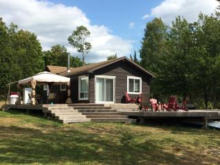 Private 36 acre Lakefront Cottage with Sandy Beach