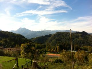 View from the balcony at La Casina - the Apuan Alps and the village tennis court
