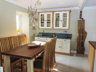 Dining area with seating for 6. Large walnut and oak island also seats guests.