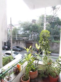 Balcony to the quiet street. Our front neighbour is a private garden. View to the hills of Sumaré