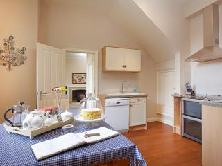 Open plan dining kitchen with fan oven, halogen hobs, dishwasher, microwave etc.