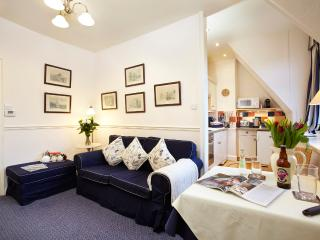Open plan lounge with Virgin Media Cable TV, Bluetooth stereo and free wi-fi