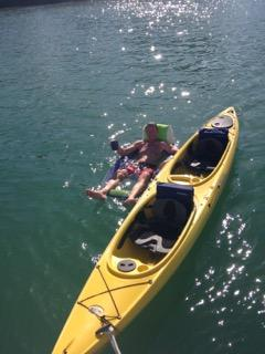 Picture of my husband beside kayak.   We have two tandem kayaks available for rent.
