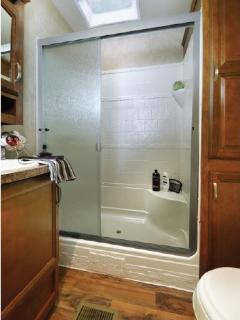 Full size shower with skylight
