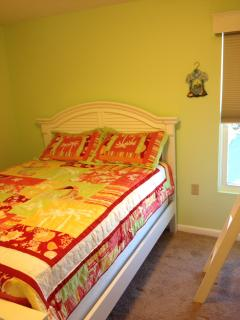 Bedroom #3 A queen bed and a set of bunk beds.