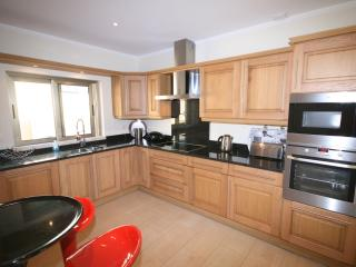 Large kitchen with integrated AEG appliance, including oven, hob, micorwave, dishwasher, washer/dry.