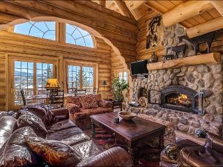 Living Room - HDTV, DVD, Wood Burning Fireplace, Vaulted Ceilings.