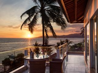 Enjoy a sundowner on the top balcony after a hard day on the beach!