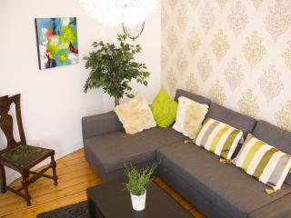 The sofa in the open-plan living, dining, kitchen area.