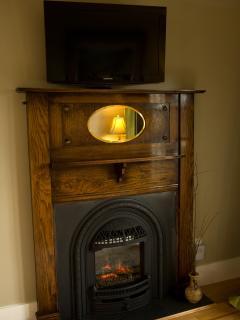 Lions' Loft Antique Fireplace Surround & Flat Screen TV