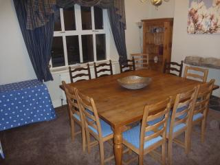 The huge solid oak dining table comfortably seats 12 for family meals or special dinner parties