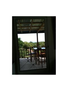 Doorway to balcony with ocean view.