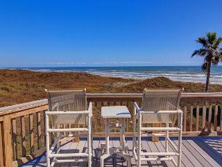 Fabulous beachfront 4 bedroom 4 bath home! Community pool and lush landscape!