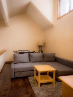 The large sectional in the loft pulls out to become a double bed.