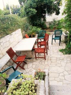 Large terrace with patio and traditional stone table and bench.