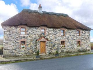 AN MAIDE BAN, detached, thatched cottage, games room, multi-fuel stove, in