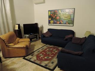 Living room with TV LCD and  armchair and sofas