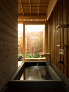 Soak in our authentic granite ofuro (Japanese bath) with views of the maple tree and cherry blossoms