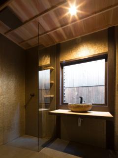 wabi sabi hand crafted granite basin in 100 year old timber counter top