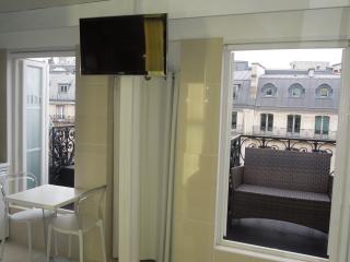 Living room/bedroom opens on 1st balcony. Brand new TV