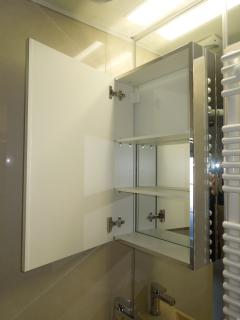 Large mirrored bathroom cabinet with lots of room for your toiletries.