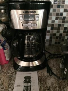 Coffee maker and filters provided.