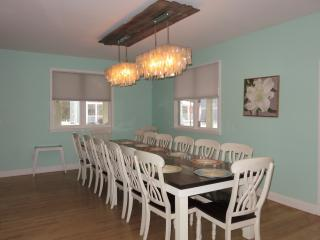 Custom 12 foot dining table with sea shell chandelier