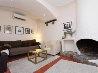 Charming fireplace and air con in the sitting room
