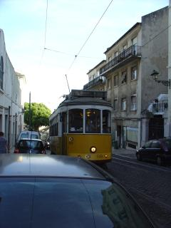 28 old tram passing in the street of the apartment.