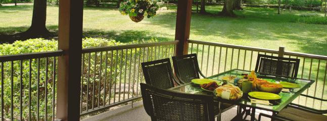Enjoy a meal on our beautiful front porch...one of our many dining with nature areas