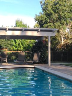 Enjoy the sun or relaxing in the shade of poolside pergola.